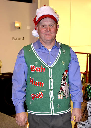 in a christmas vest