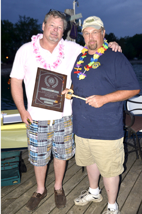 Bryan Smith, the upcoming club president presents 2014-2015 club president Jeff Glass with the Club President's Leadership Plaque  copy