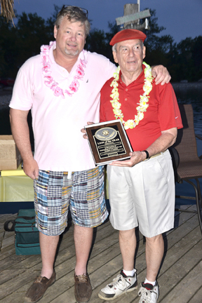 Jeff Glass presents Lion Gene Haseley with a Lion of the Year plaque