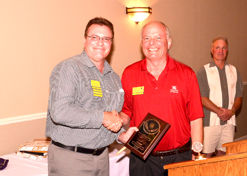 Outgoing 2012-13  President Will Ruemmle receives his President's Placque from 2013-14 incoming President Ray Jacobson