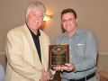 Will Ruemmele presents Bill Henry with the Club Treasurer Plaque
